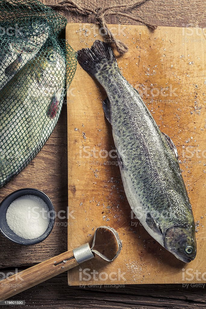 Preparing freshly caught trout royalty-free stock photo