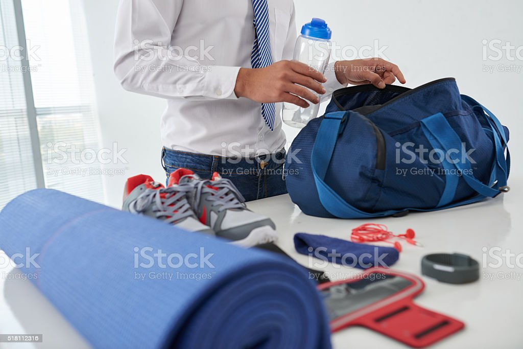 Preparing gym bag stock photo