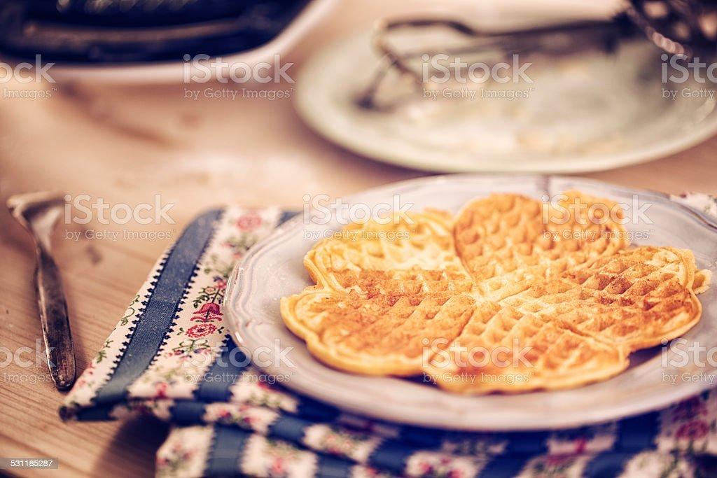 Preparing Heart Shaped Waffles stock photo