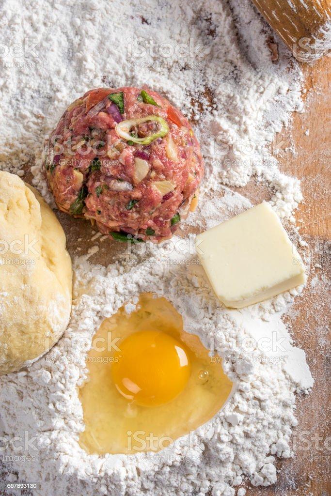 Preparing Homemade Beef Stuffed Empanada stock photo
