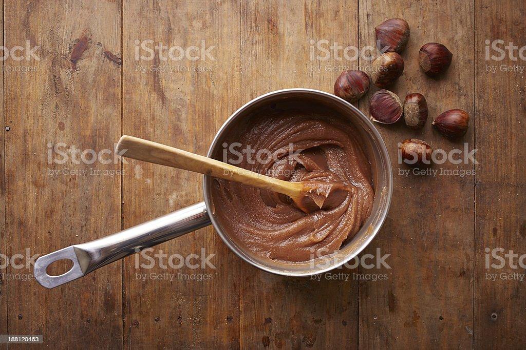Preparing homemade chestnut cream on a pot stock photo