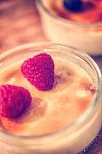 Preparing Homemade Creme Brulee with Berries