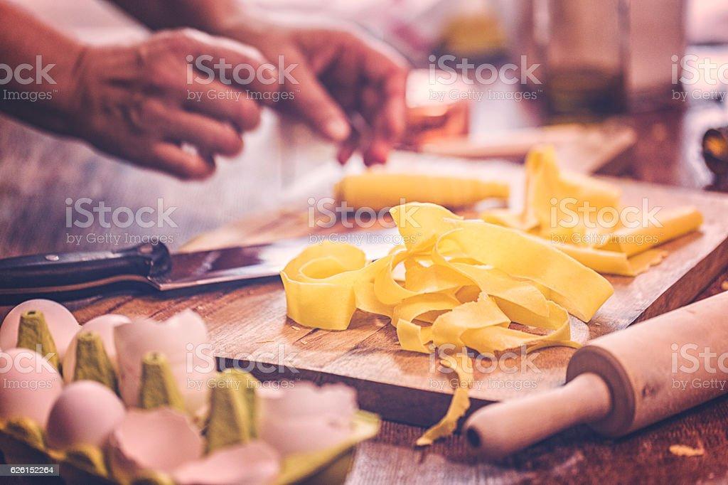 Preparing Homemade Pasta in Domestic Kitchen stock photo
