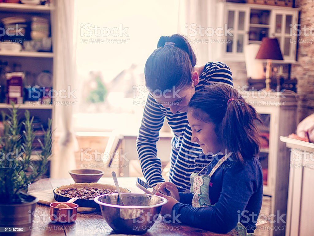 Preparing Homemade Pecan Pie for the Holidays stock photo