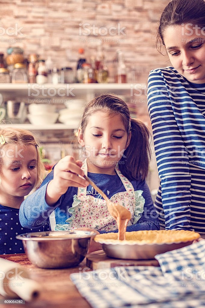 Preparing Homemade Pumpkin Pie for the Holidays stock photo