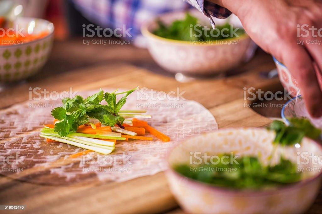 Preparing Homemade Spring Rolls with Fresh Vegetables stock photo
