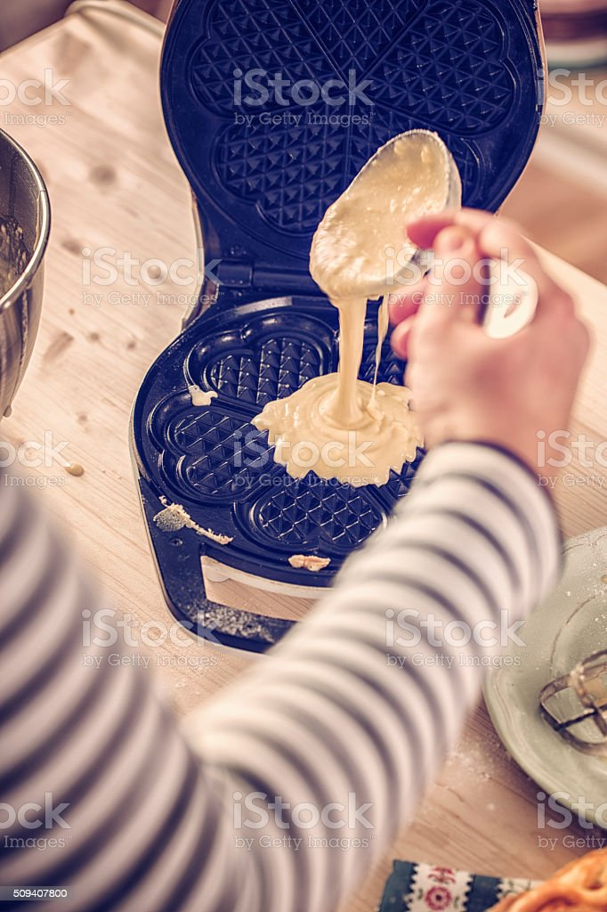 Preparing Homemade Waffles in Waffle Iron stock photo