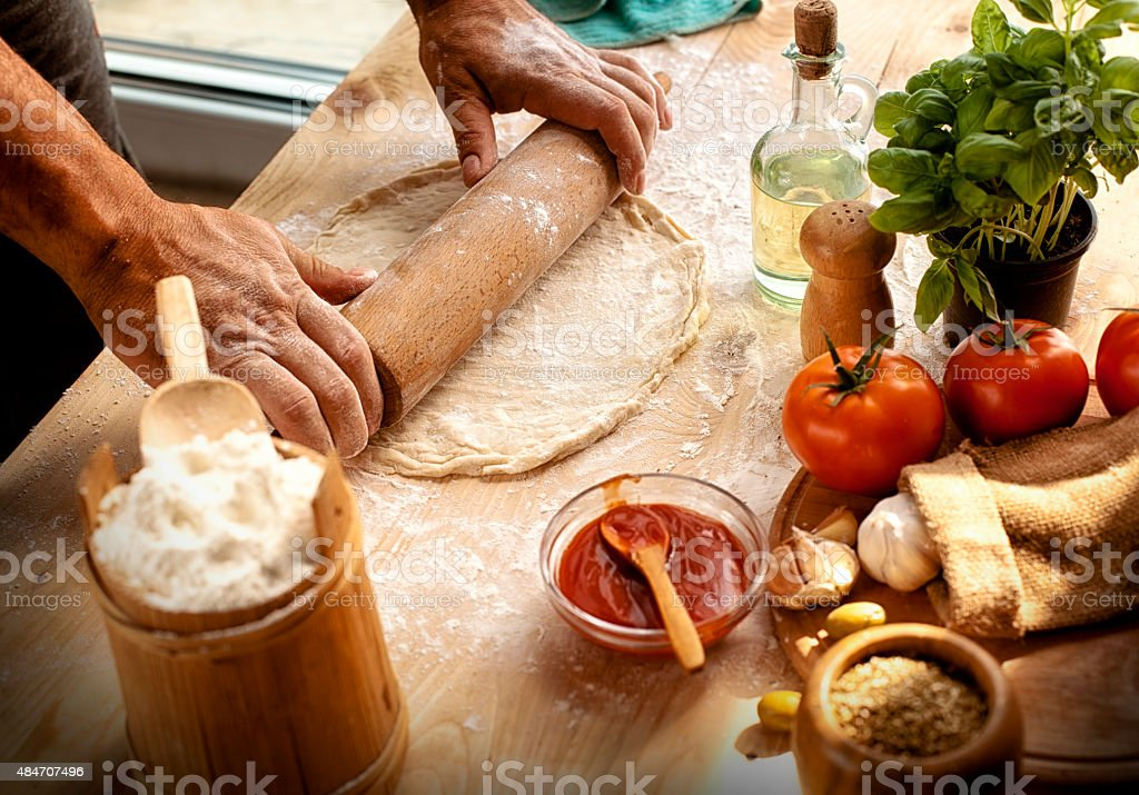 Preparing ingredients of homemade pizza stock photo