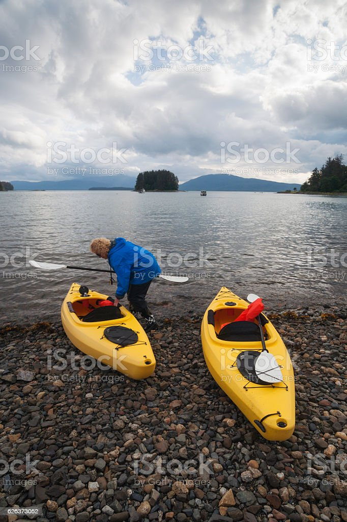 Preparing kayaks for a journey stock photo
