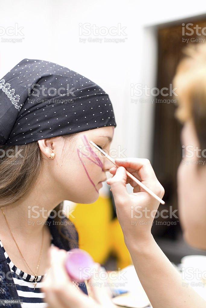 Preparing make up to actress before scene royalty-free stock photo