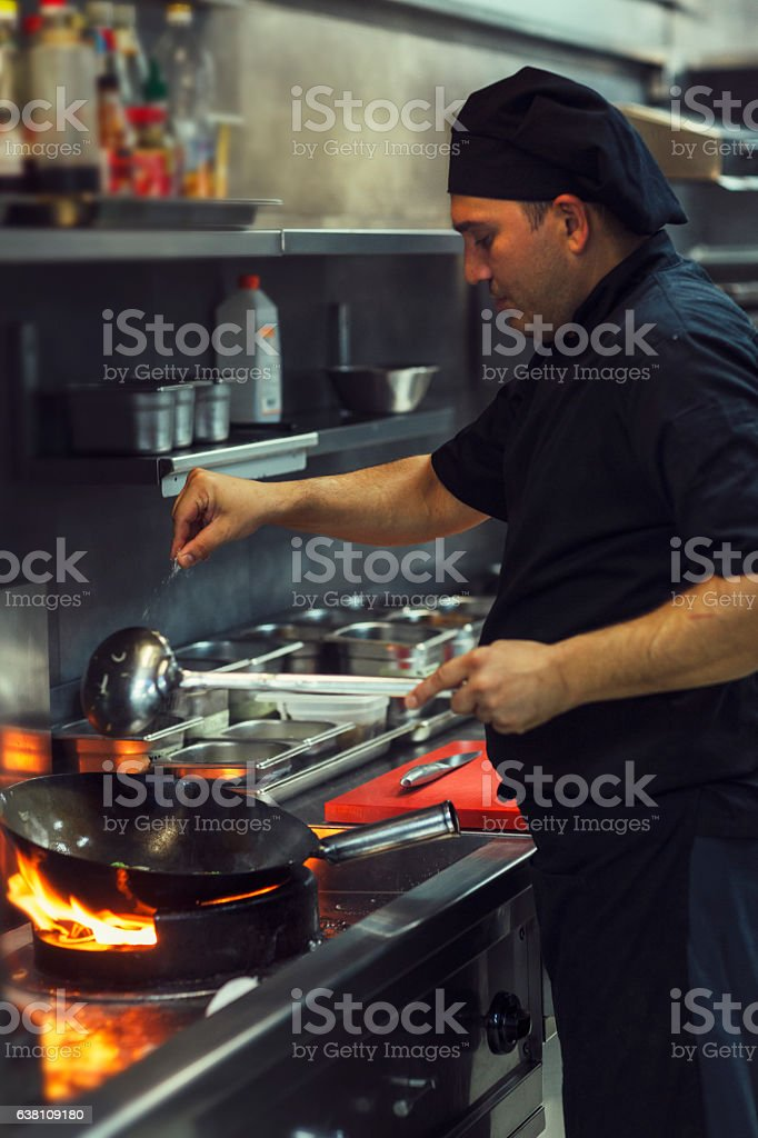 Preparing Meal In A Wok. stock photo