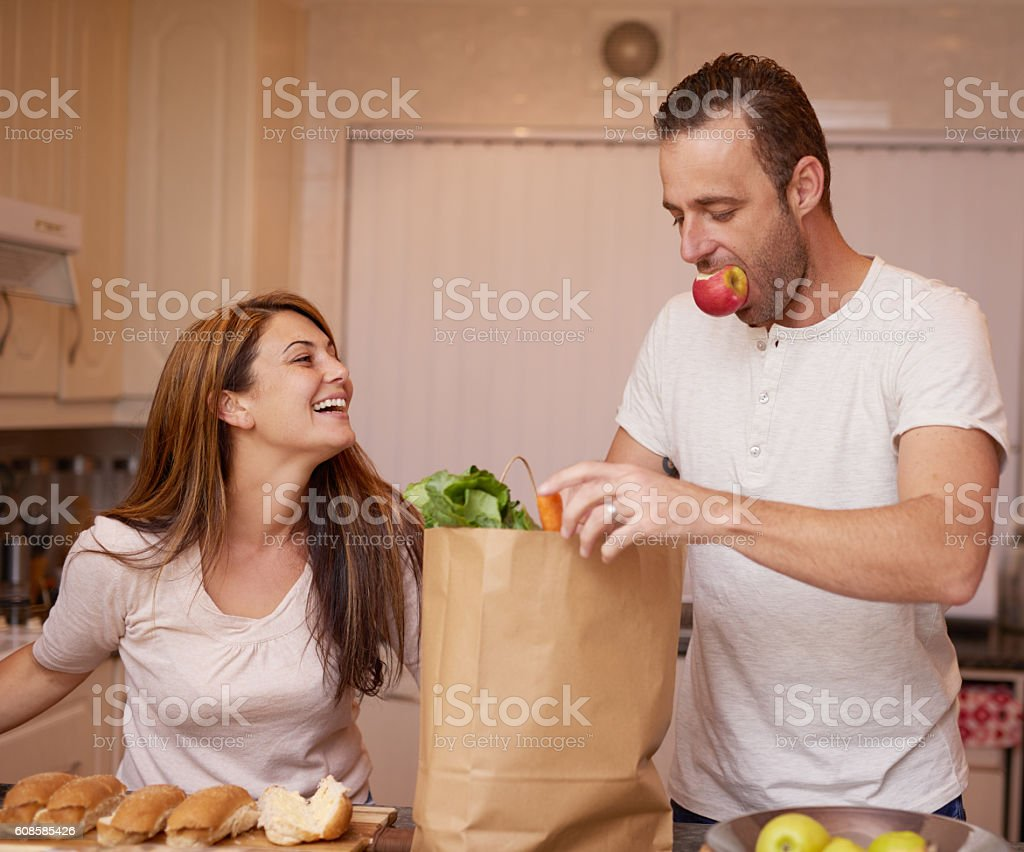 Preparing meals together stock photo