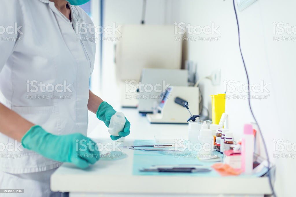 Preparing medicine in medical laboratory stock photo
