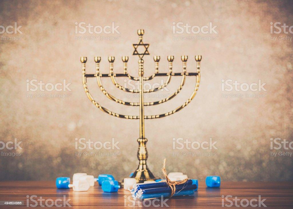 Preparing Menorah for Hanukkah stock photo