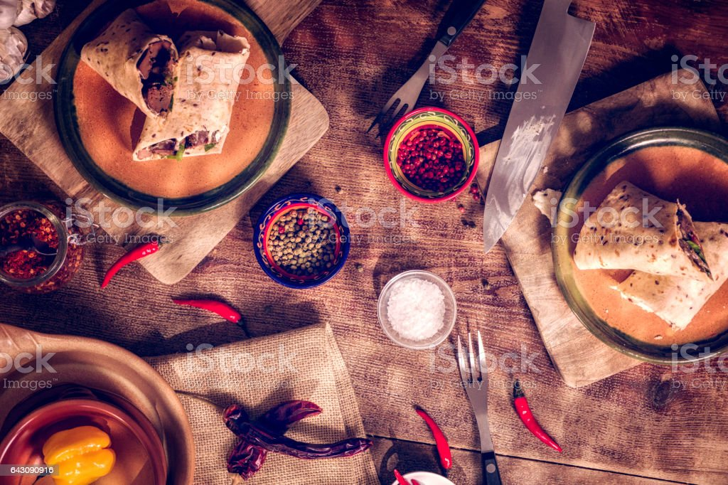 Preparing Mexican Wraps with Spicy Beef and Sour Cream stock photo
