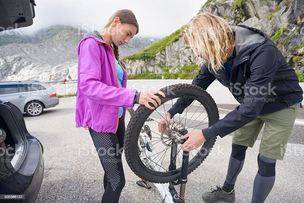 Preparing Mountain Bikes for Ride in the Mountains stock photo