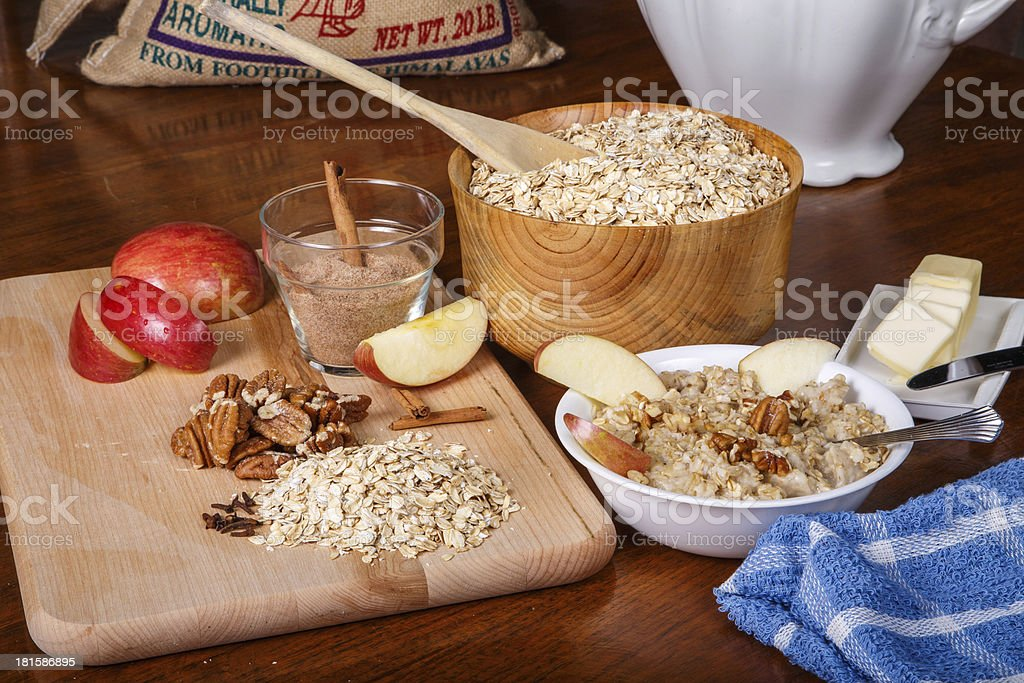 Preparing Oatmeal with Spices Nuts and Fruit royalty-free stock photo