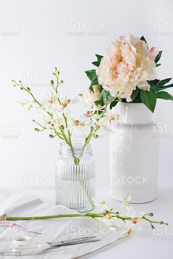 Preparing orchids cut flowers in vases for home decoration stock photo