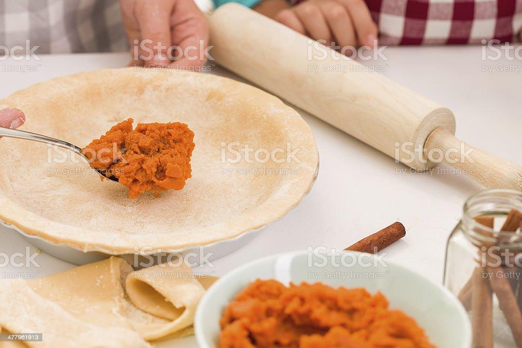 Preparing Pumpkin Pie for Autumn Days royalty-free stock photo