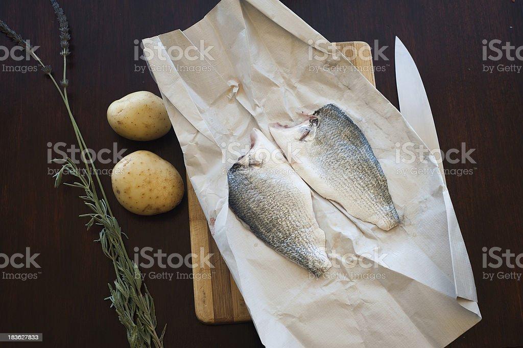 Preparing raw fish stock photo