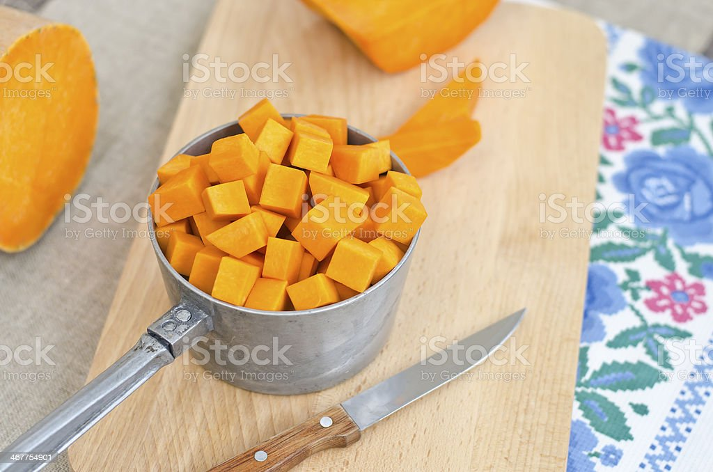 Preparing raw pumpkin for cooking royalty-free stock photo