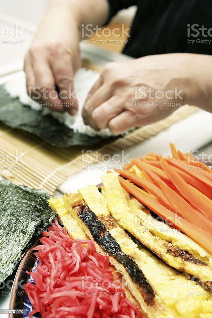 Preparing Rice on Seaweed for Sushi royalty-free stock photo