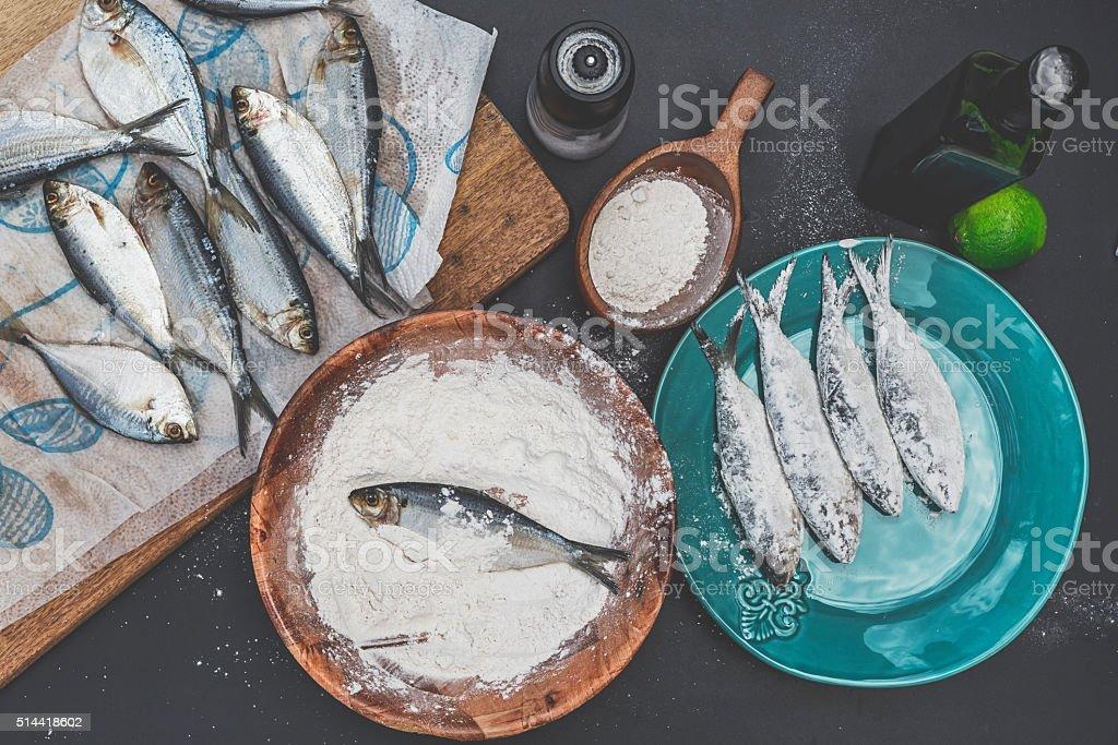 Preparing Sardines to Fry stock photo