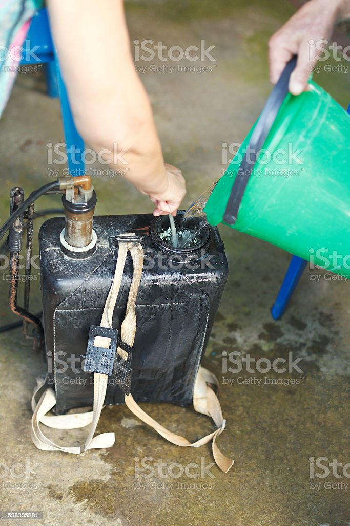 preparing solution of pesticide stock photo
