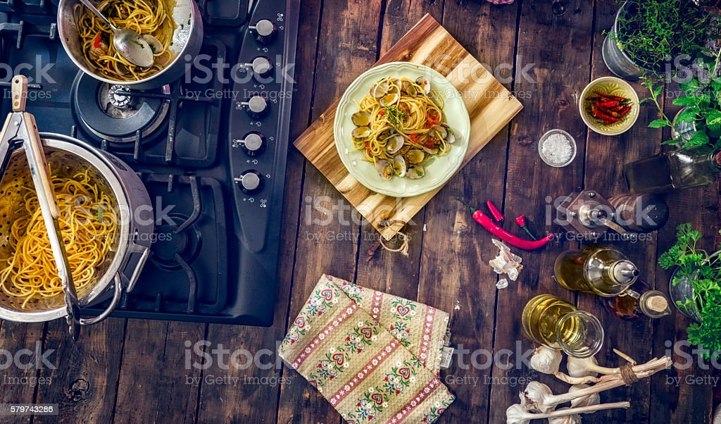 Preparing Spaghetti alla Vongole stock photo