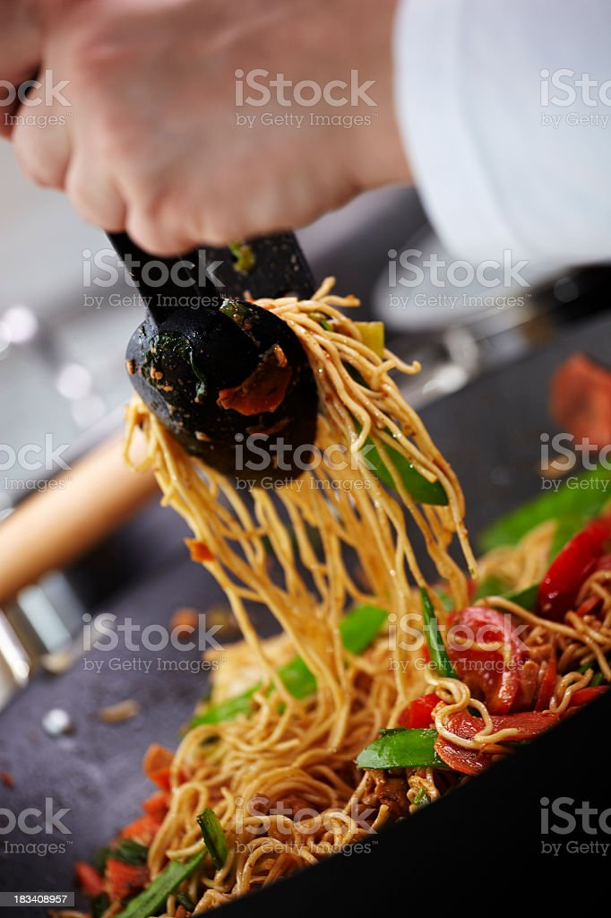 Preparing stir fried noodles stock photo