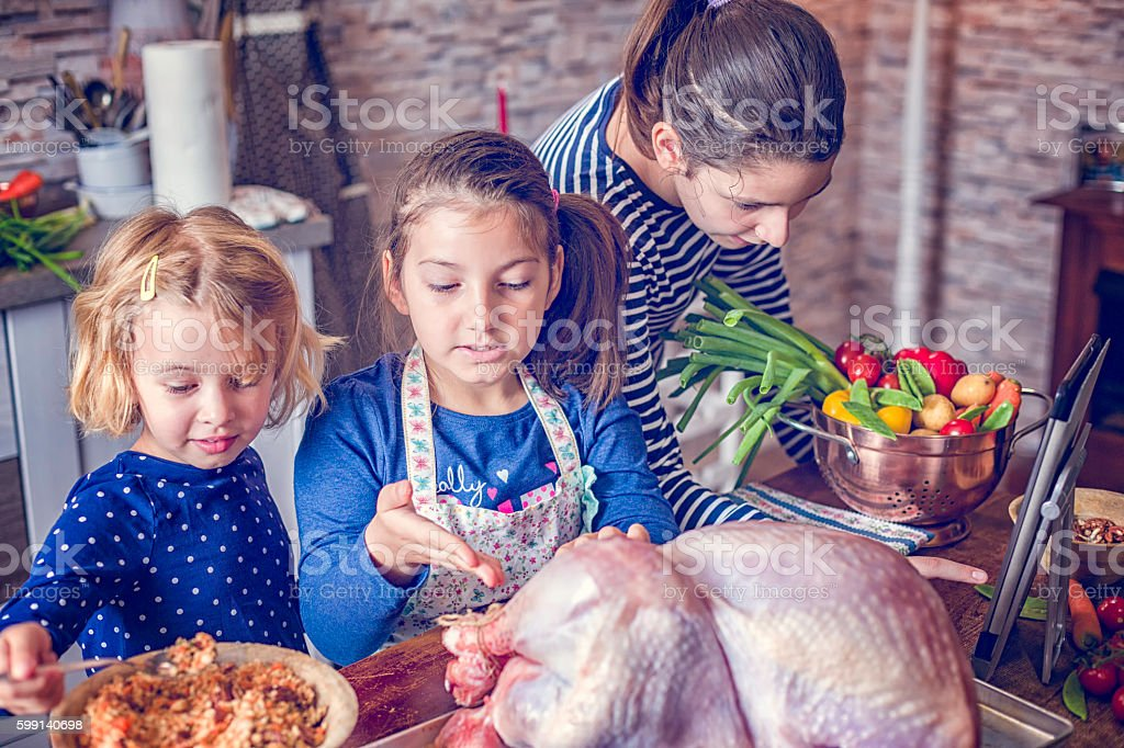 Preparing Stuffed Turkey with Vegetables for Holiday Dinner stock photo