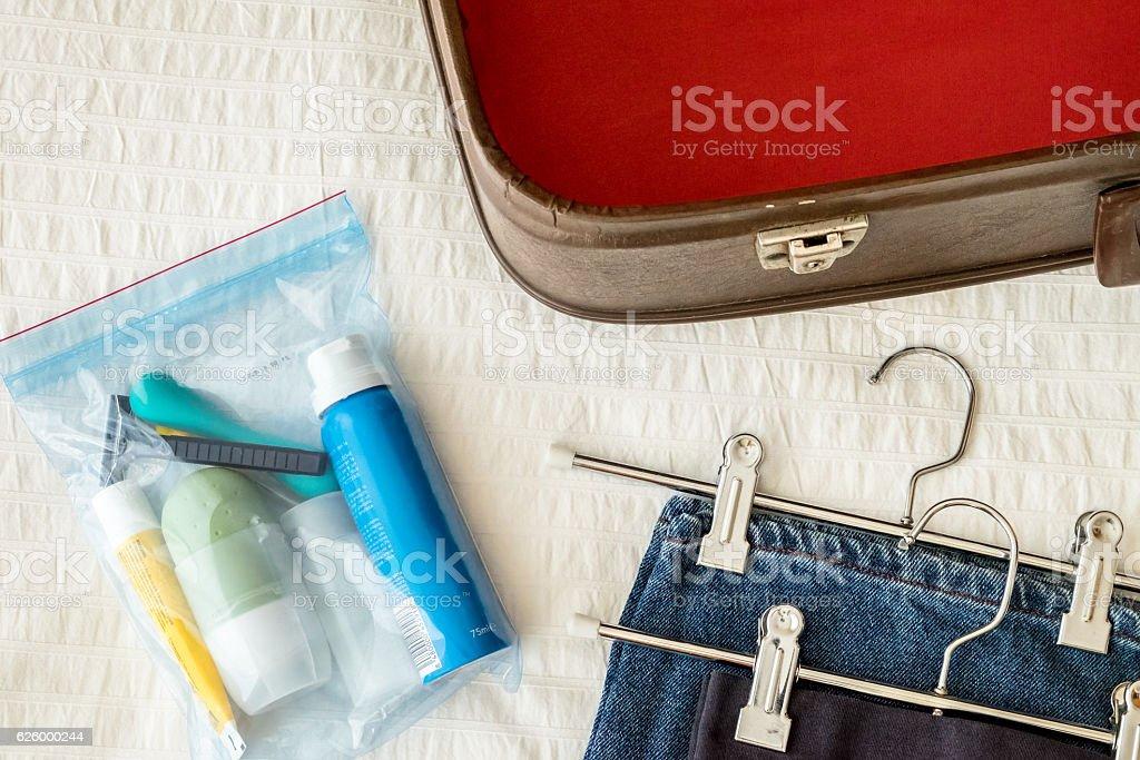 Preparing suitcase. Toiletry. stock photo