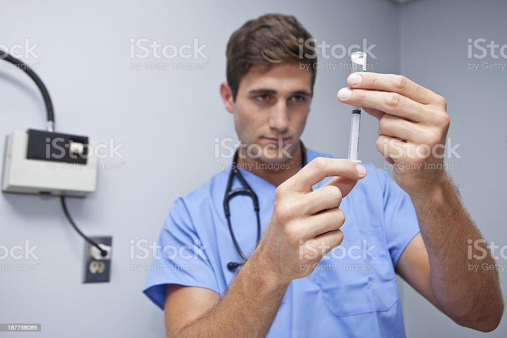 Preparing syringe stock photo