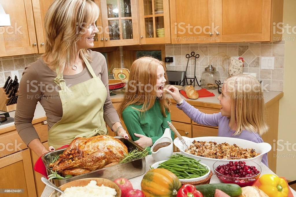 Preparing Thanksgiving and Christmas Family Dinner with Kids in Kitchen stock photo