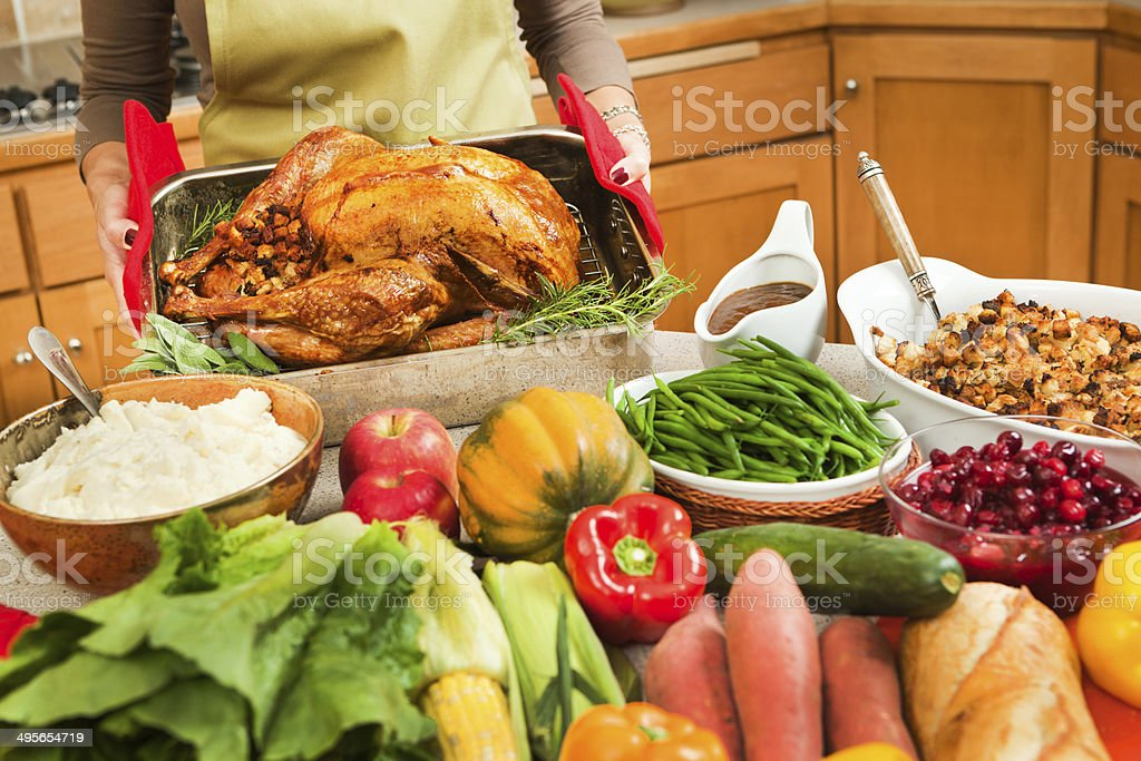 Preparing Thanksgiving and Christmas Turkey Dinner Feast in Home Kitchen stock photo