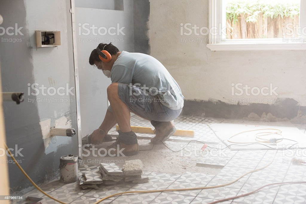 Preparing the bathroom floor for tiling stock photo