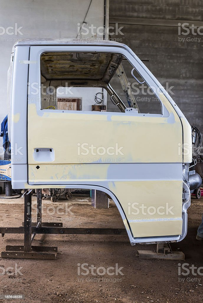 Preparing the body of a car stock photo