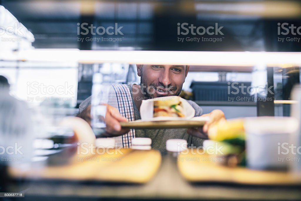 Preparing the food display stock photo
