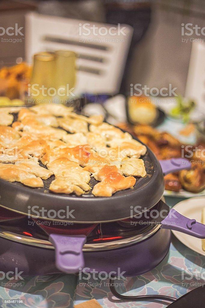 Preparing the raclette machine stock photo