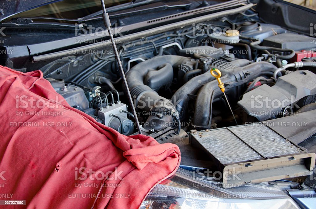 Preparing to Change Motor Oil in a Car stock photo
