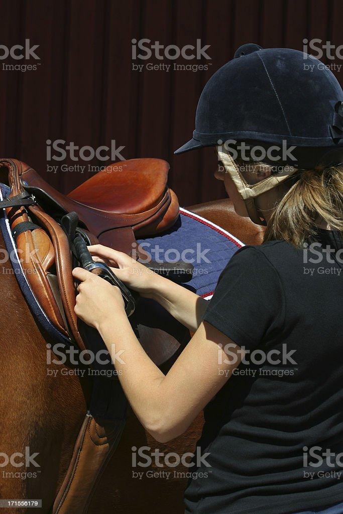 Preparing to go horseback riding royalty-free stock photo