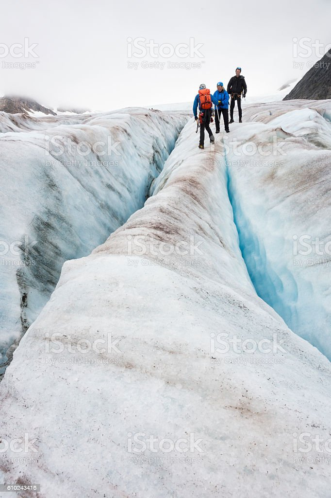 Preparing to hike between crevasses stock photo