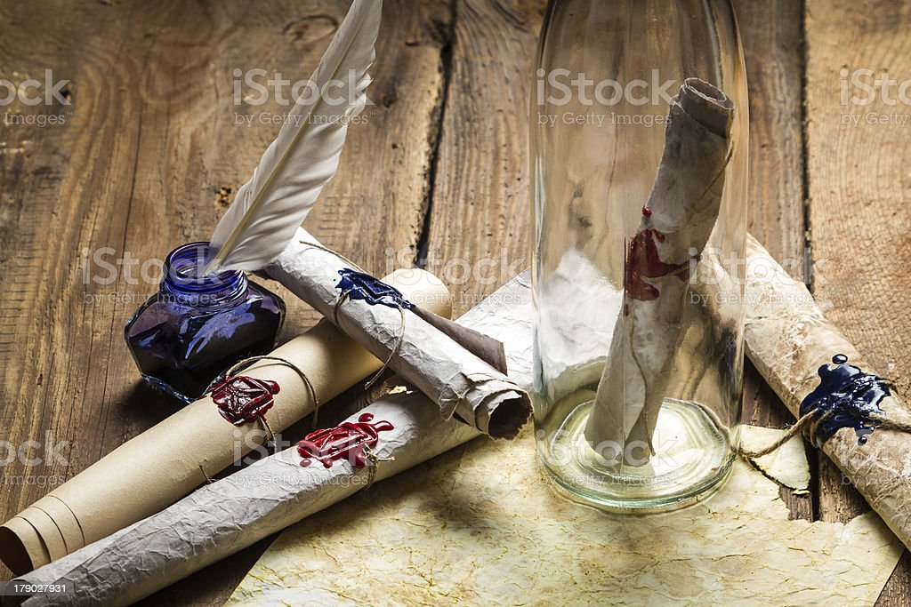 Preparing to send ancient letter in a bottle royalty-free stock photo