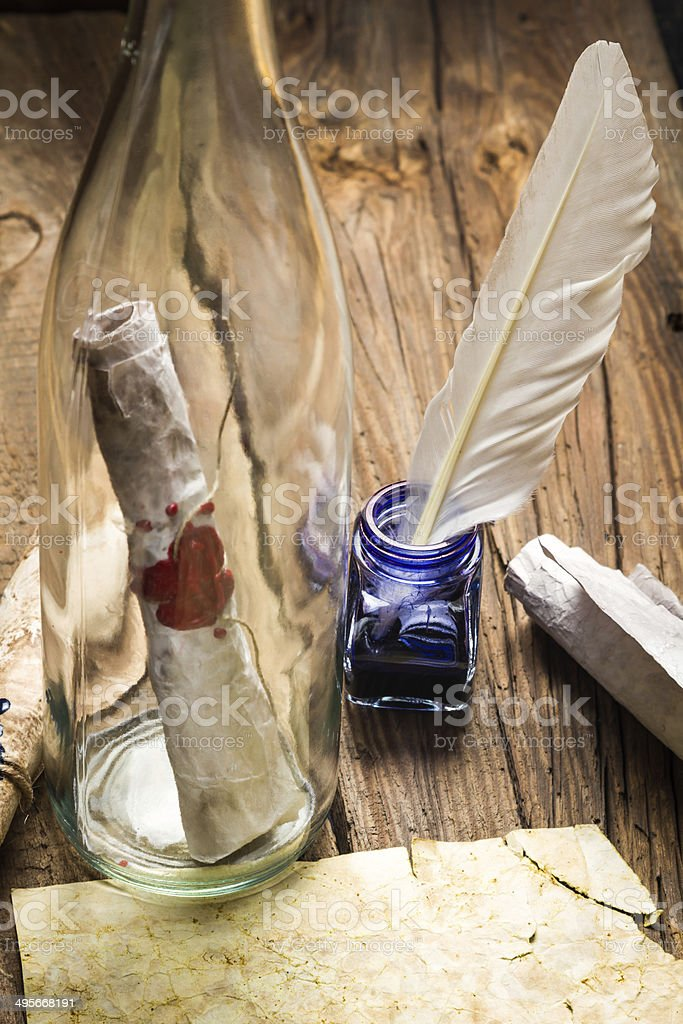 Preparing to send ancient letter in a bottle stock photo