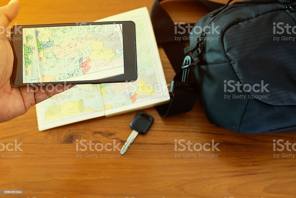 Preparing to Travel Concept, Hand Hold Mobile Phone stock photo