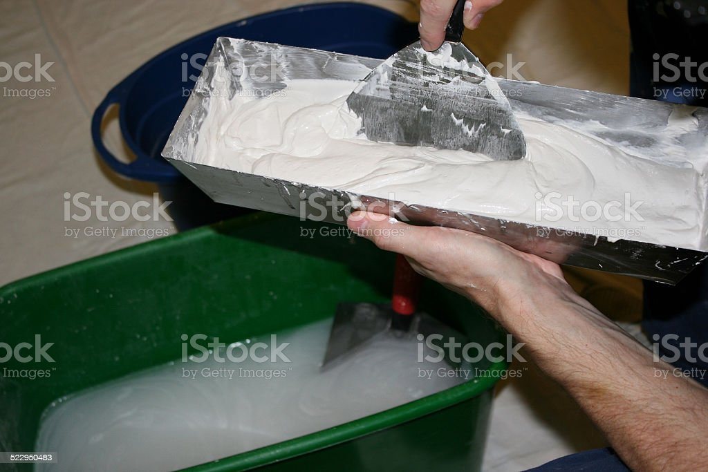 Preparing to use Spackling on Drywall stock photo
