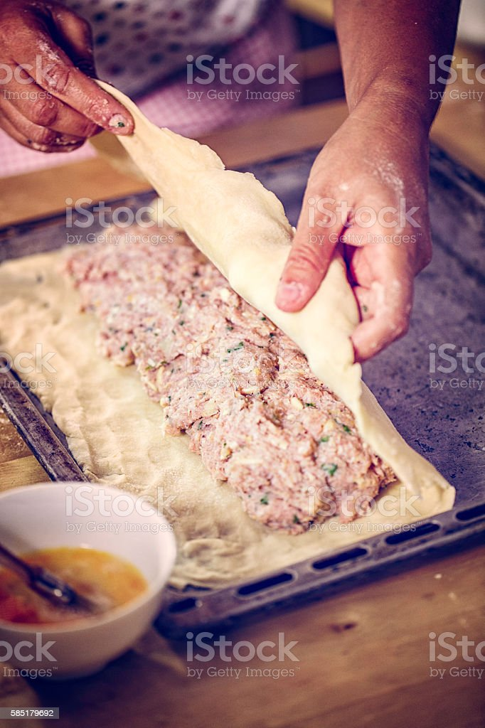 Preparing Toad-in-a-Hole Meat Pie stock photo