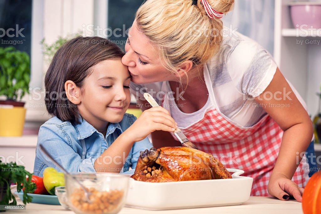 Preparing Turkey for Thanksgiving Dinner stock photo