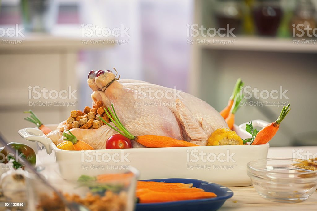 Preparing Turkey for Thanksgiving Dinner stock photo