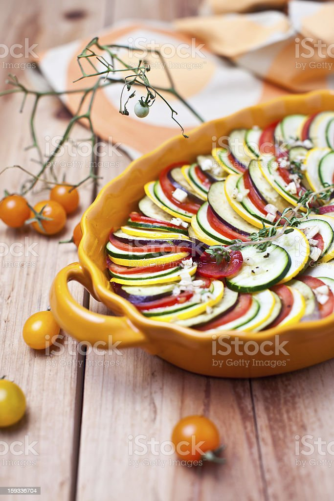 Preparing vegetable gratin on a wooden background royalty-free stock photo